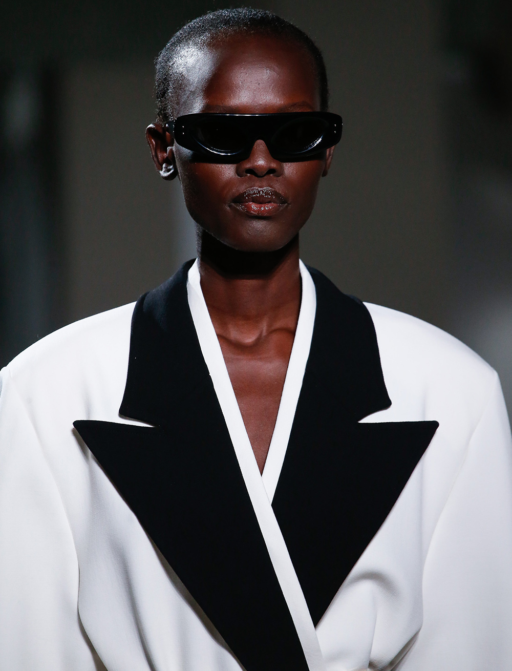 Detail image of runway model with sunglasses from the Spring/Summer 2020 Runway show