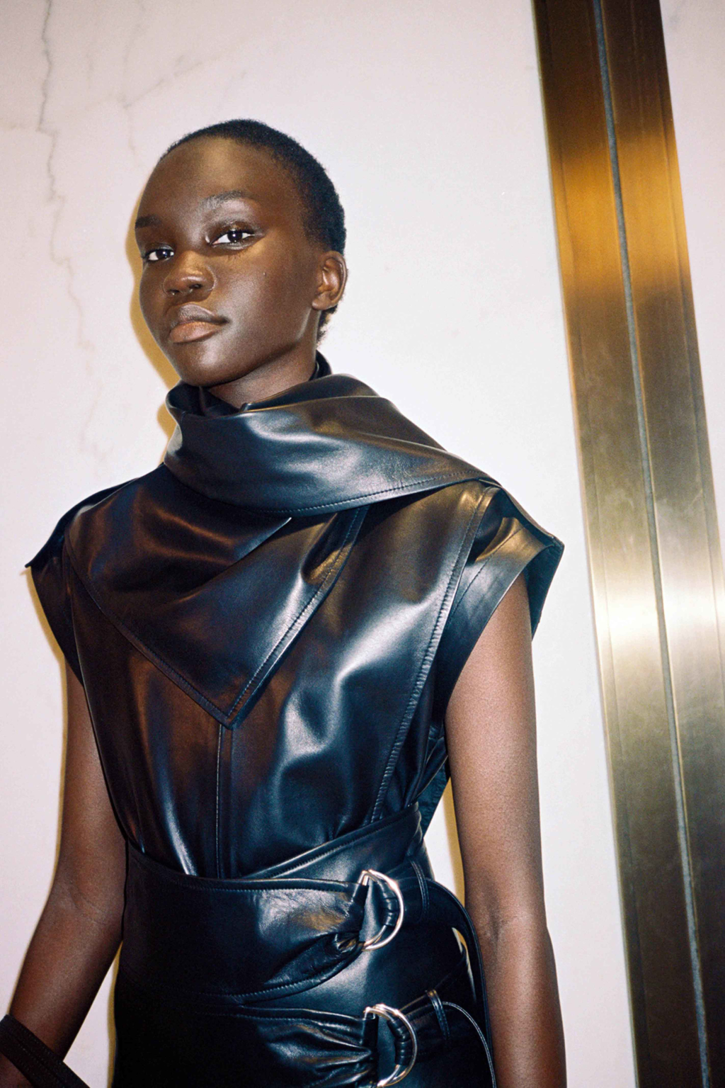 Image of Model wearing leather scarf top from Pre-Spring 2020