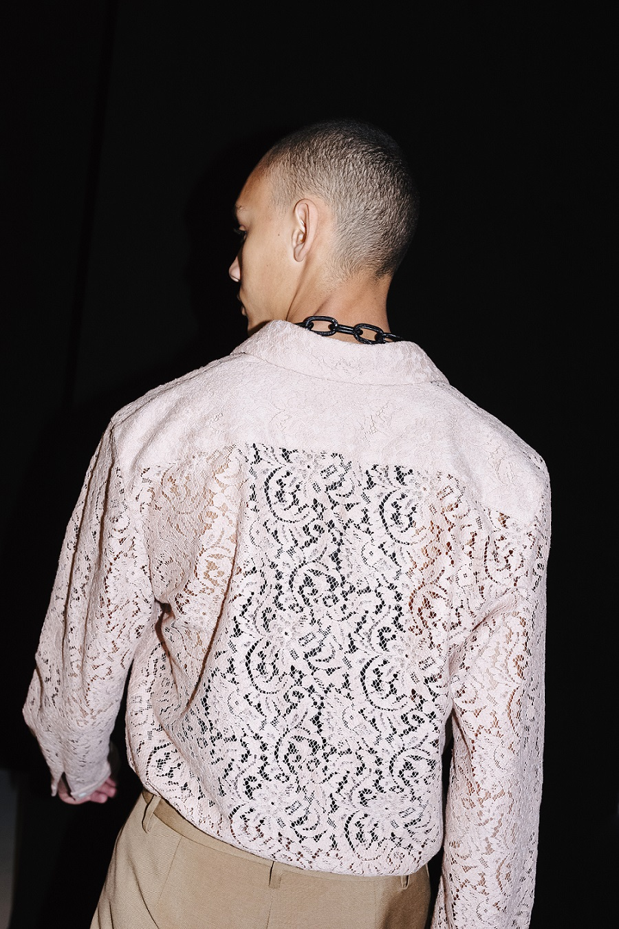 male model with lace nude color shirt