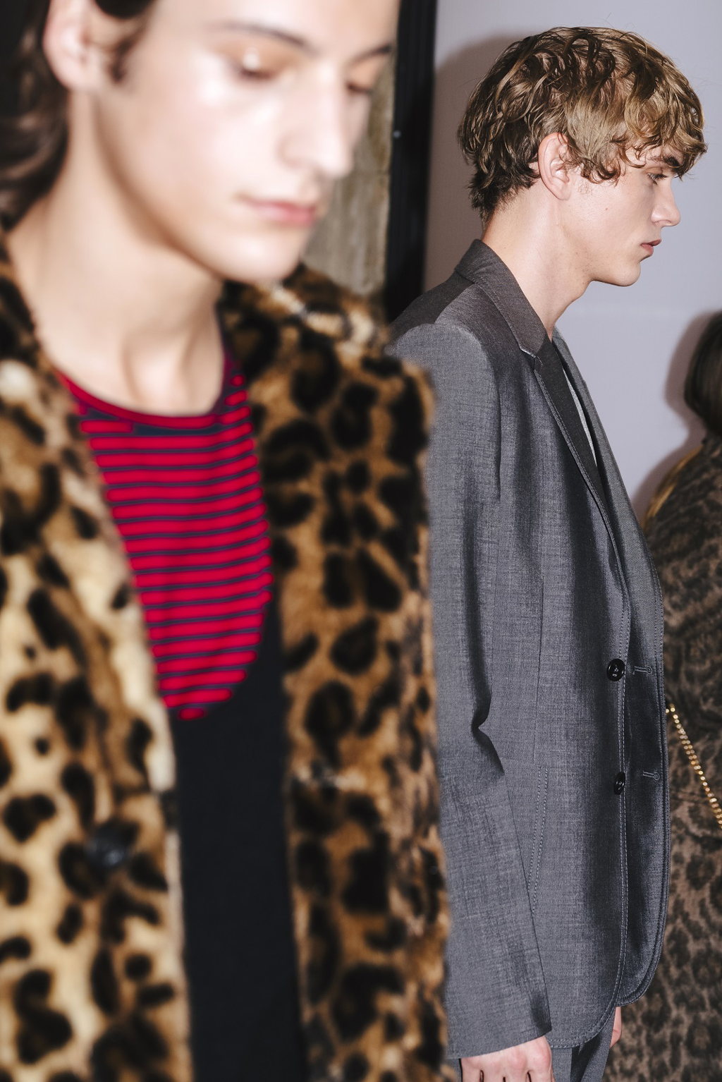 male model with leopard print jackets and male model with gray suit